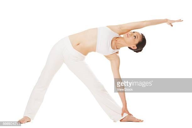 the young woman is doing yoga - gymnastique douce photos et images de collection