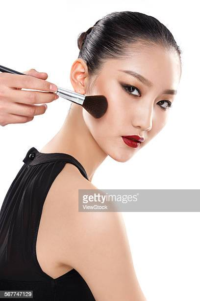 The young woman is makeup