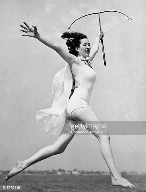 The young woman winner of the crossbow archery contest at Nassau Shore Country Club does a graceful terpsichorean emulation of 'The Goddess of the...