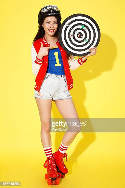The young woman with a circular target
