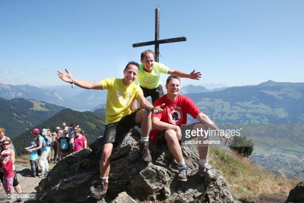 The Young Zillertaler Michael Markus and Daniel pose prior to the beginning of this year's fan hiking tour on the Spieljochberg mountain above the...