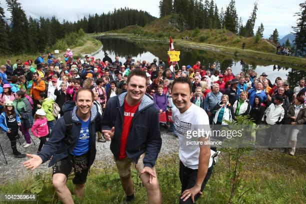 The Young Zillertalers Daniel Prantl Michael Ringler and Markus Unterladstaetter pose with thier fans during hike in the Tux Alps in Zillertal near...