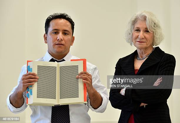 The younger brother of Mohamedou Ould Slahi Yahdih Ould Slahi and US attorneyNancy Hollander poses with a copy of Yahdih's prison memoir 'Guantanamo...
