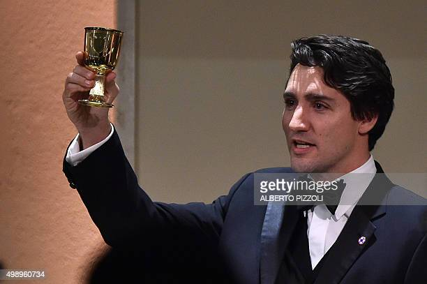 The youngest head of state of Commonwealth countries Canadian Prime Minister Justin Trudeau celebrates a toast in honor of Queen Elizabeth II during...