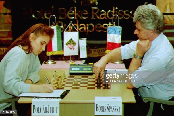 The youngest international chess grand master, 17-year-old Judit Polgar writes down her first move 16 February, 1993 in her last match with Russian...