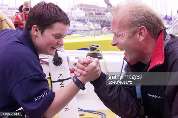 The youngest sailor to take part in the TRANSAT race 23year old Ellen MacArthur of Derbyshire Great Britain arm wrestles with compatriot and...