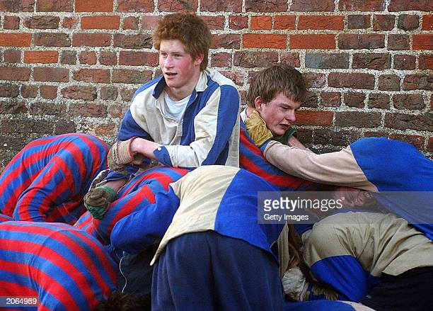 The youngest son of the Prince of Wales Prince Harry and his brother Prince William take part in the Wall Game between Dr Gailey's Old Boys and the...