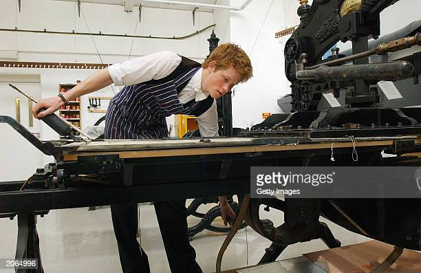 The youngest son of the Prince of Wales Prince Harry operates a 120yearold Colombian relief printing press on May 12 2003 in the Drawing School at...