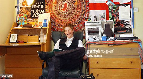 The youngest son of the Prince of Wales Prince Harry poses for a photograph on May 12 2003 in his room at Eton College Eton in England Prince Harry...