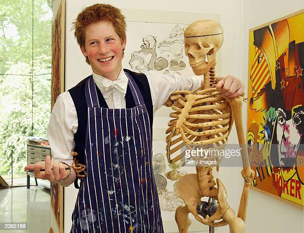 The youngest son of the Prince of Wales Prince Harry poses next to a skeleton in Eton College's Drawing School which was opened last autumn by the...