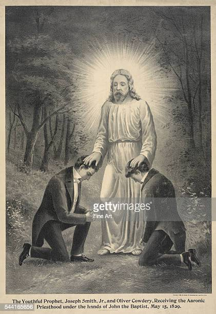 The youthful prophet Joseph Smith Jr and Oliver Cowdery receiving the Aaronic priesthood under the hands of John the Baptist May 15 1829