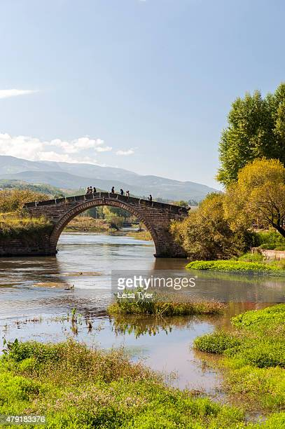 The Yujin Bridge in Shaxi an ancient trading town for caravans plying the Tea Horse Trail in Jianchuan County Yunnan province China Shaxi is...
