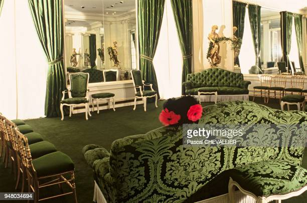 The Yves Saint Laurent Couture House decoration by Jacques GRANGE On the sofa in the foreground a black astrakhan pillbox shaped toque decorated with...