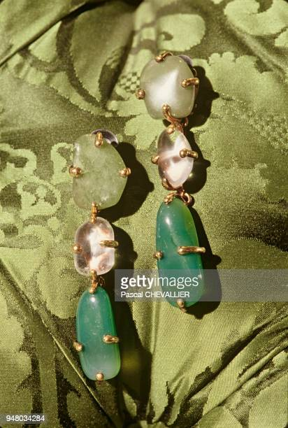 The Yves Saint Laurent fashion house decoration by Jacques GRANGE On the couch's damask padding Baroque earrings in rock crystal and hard rock Haute...