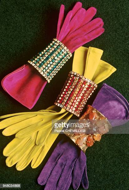 The Yves Saint Laurent fashion house decoration by Jacques GRANGE Copper saffron and amethyst colors suede gloves decorated with paste cuff bracelets...
