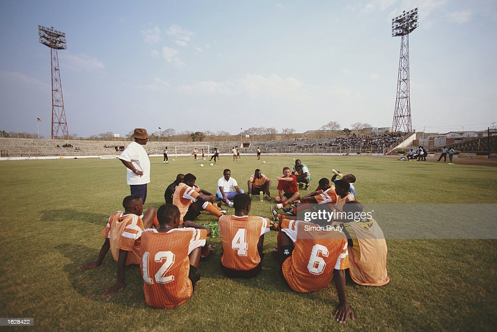 The Zambian team are coached by Ian Porterfield (left standing) during a training session in Zambia. \ Mandatory Credit: Simon Bruty/Allsport