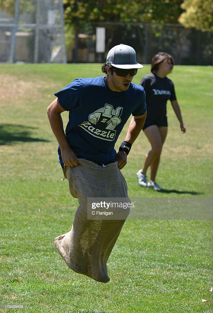 The Zazzle Team completes in the Burlap Sack Race during the Founder Institute's Silicon Valley Sports League event on July 13, 2013 in Palo Alto, California.