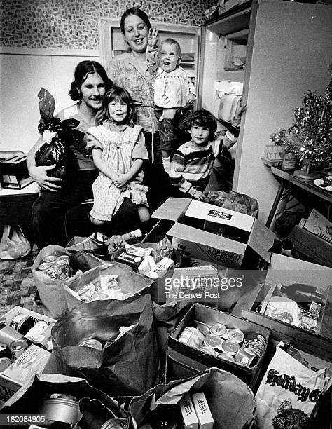 DEC 26 1981 DEC 24 1982 The Zeobor family was sacked in with food and gifts Christmas Day From left to right are Ken Chastity Kim Sisina 1 1/2 and...