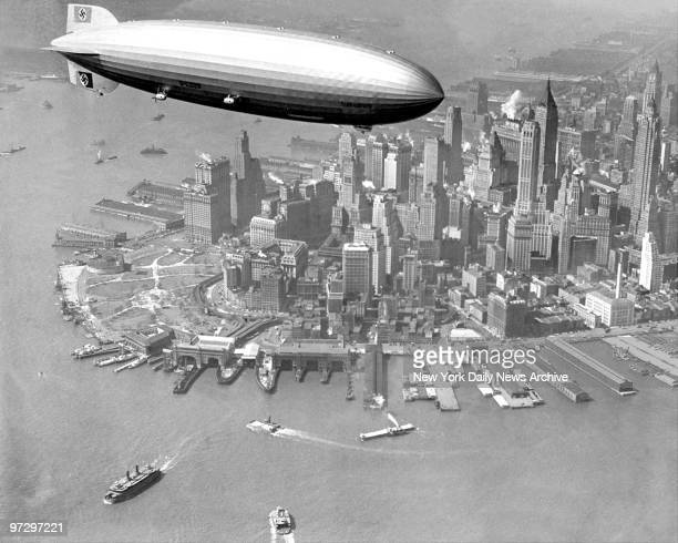 The zepplin Hindenburg flies over Manhattan