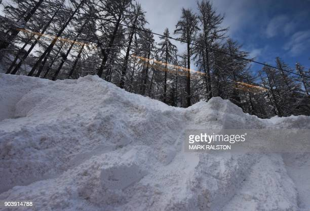 The Zermatt to Tasch train passes by the scene of an avalanche as train services resumed to evacuate tourists after heavy snowfall and avalanches had...