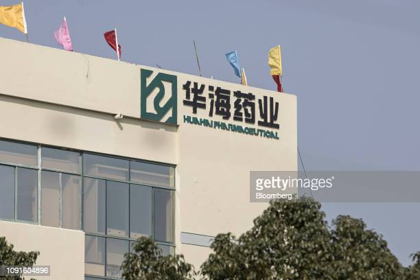 The Zhejiang Huahai Pharmaceuticals Co logo is displayed at the company's Chuannan branch production base in Linhai Zhejiang Province China on...