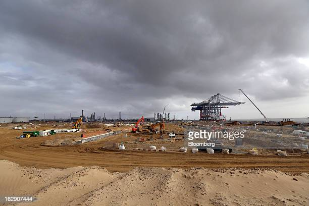 The Zhen Hua 26 a semisubmersible heavy load carrier operated by Shanghai Zhenhua Heavy Industry Co Ltd is seen beyond a construction site as it...