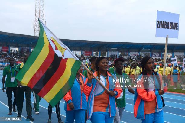 The Zimbabwean contingent marches during the opening of the 21st African Senior Athletics Championships at the Stephen Keshi Stadium in Asaba Delta...