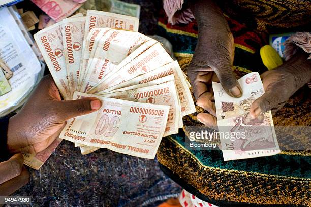 The Zimbabwean Dollar left made up of various denominations held with a twenty South African Rand note right in Harare Zimbabwe on Thursday April 23...