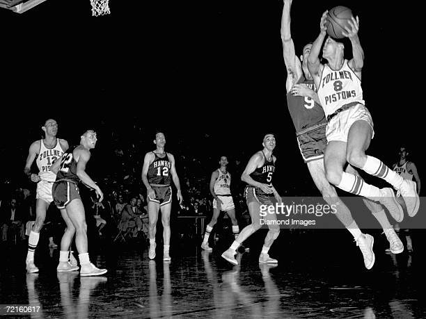The Zollner Pistons tries to score as Bob Pettit of the St Louis Hawks tries to block the shot during a Western Division Playoff game in March 1956...