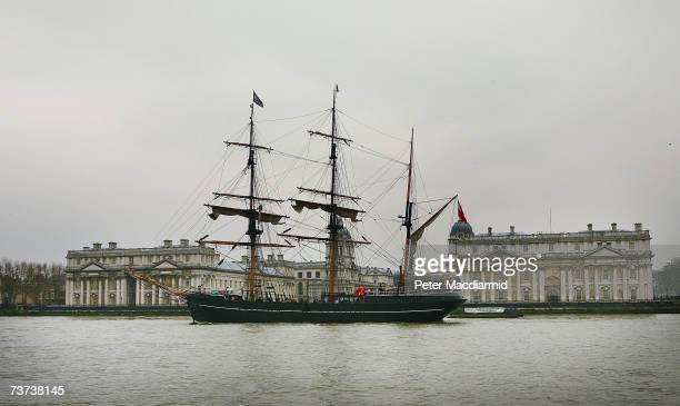 The Zong a replica 18th century wooden square rigger ship sails past the Old Royal Naval College on the River Thames on March 29 2007 in London...