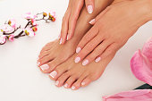 The zoom to the beautiful done pedicure and manicure. Studio shoot.