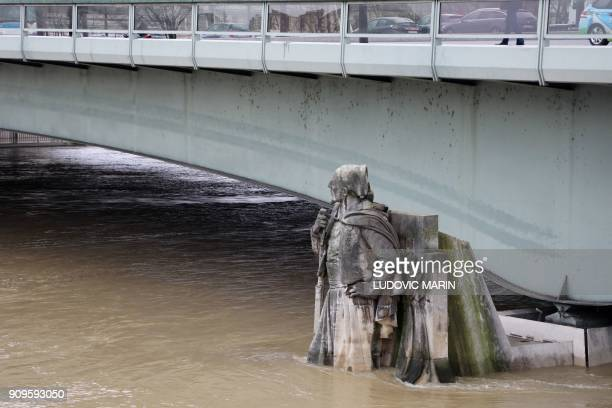 The Zouave statue at the Pont D'Alma bridge stands partially submerged after the River Seine burst its banks in Paris on January 24 2018 / AFP PHOTO...