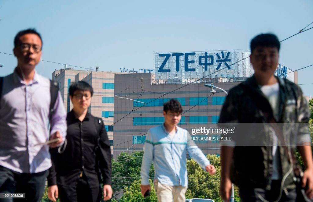 The ZTE logo is seen on an office building in Shanghai on May 3, 2018. - Senior US officials arrive in Beijing for trade talks with China, as both sides dampen expectations for a quick resolution to the heated dispute between the world's two largest economies.