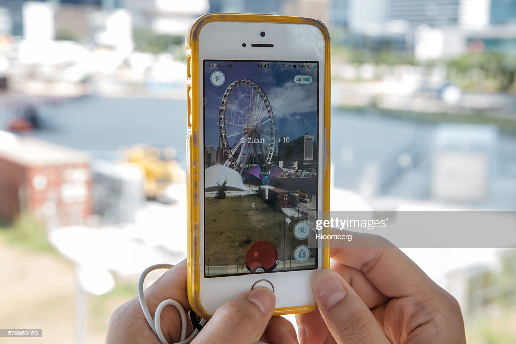 The Zubat character of Nintendo Co.'s Pokemon Go augmented-reality game, developed by Niantic Inc., is seen in front of the Hong Kong Observation Wheel on a smartphone in an arranged photograph in Hong Kong, China, on Monday, July 25, 2016. After debuting in the U.S. earlier this month, Pokemon Go launched in Japan on Friday and became available in Hong Kong on Monday. Photographer: Anthony Kwan/Bloomberg via Getty Images