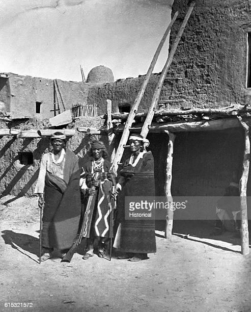 The Zuni LieutenantGovernor War Chief and Governor standing in Zuni pueblo Zuni New Mexico ca 1873