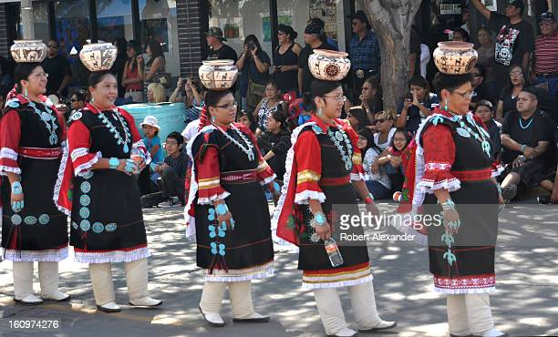 The Zuni Olla Maidens from Zuni Pueblo carrying decorated handmade pottery on their heads participate in the annual InterTribal Indian Ceremonial...