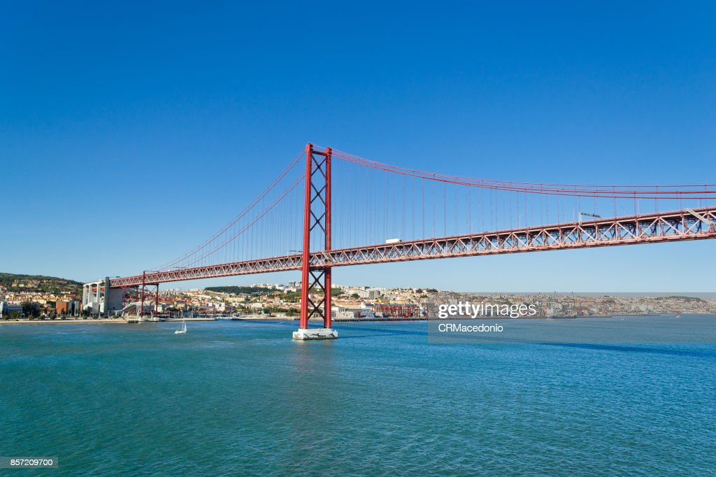 The25 de Abril Bridge(Ponte 25 de Abril) under Blue sky. : Stock Photo