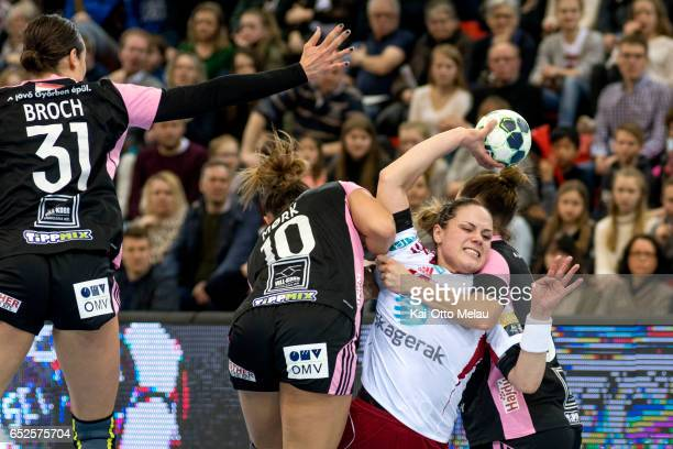 Thea Moerk tries to shoot in the game between Larvik HK and Gyori Audi ETO KC on March 12 2017 in Larvik Norway