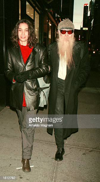 Thea Nedelcheva and Billy F Gibbons of the band ZZ Top do a little window shopping November 24 2000 on Fifth Ave in New York City