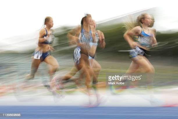 Thea Reinhardt of the ACT leads a group of runners in the Women 1500 Metres U14 final during the Australian Track and Field Championships at Sydney...