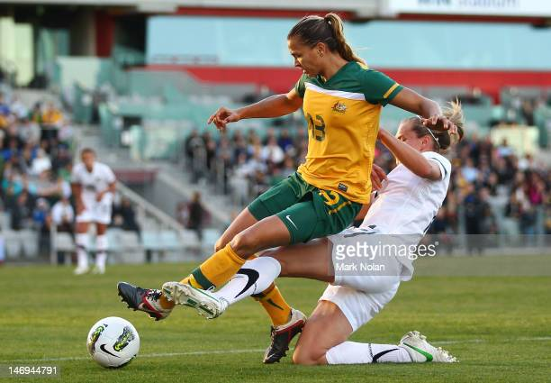 Thea Slatyer of the Matildas and Hannah Wilkinson of New Zealand contest possession during the women's international friendly match between the...