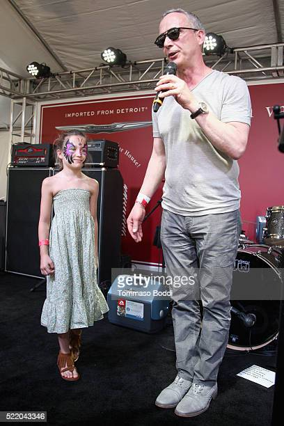Thea Varvatos and Steve Chickery speak onstage at the John Varvatos 13th Annual Stuart House benefit presented by Chrysler with Kids' Tent by Hasbro...