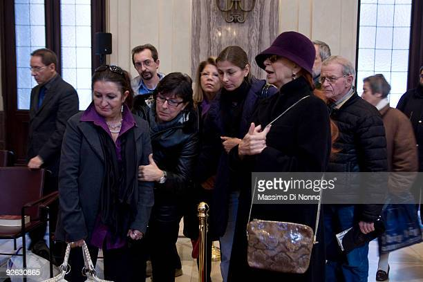 Theater actress Milva and Merini's daugthers pay their respects to Italian poetess Alda Merini at the Palazzo Marino on November 3 2009 in Milan...