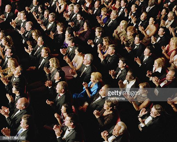 theater audience wearing formal attire, applauding, overhead view - applauding stock pictures, royalty-free photos & images