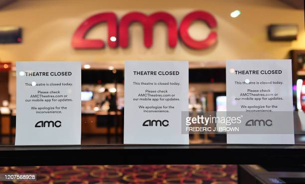 Theater Closed signs are posted in front of the AMC Montebello as the US chain of AMC movie theaters closes for 6 to 12 weeks On March 17 2020 in...
