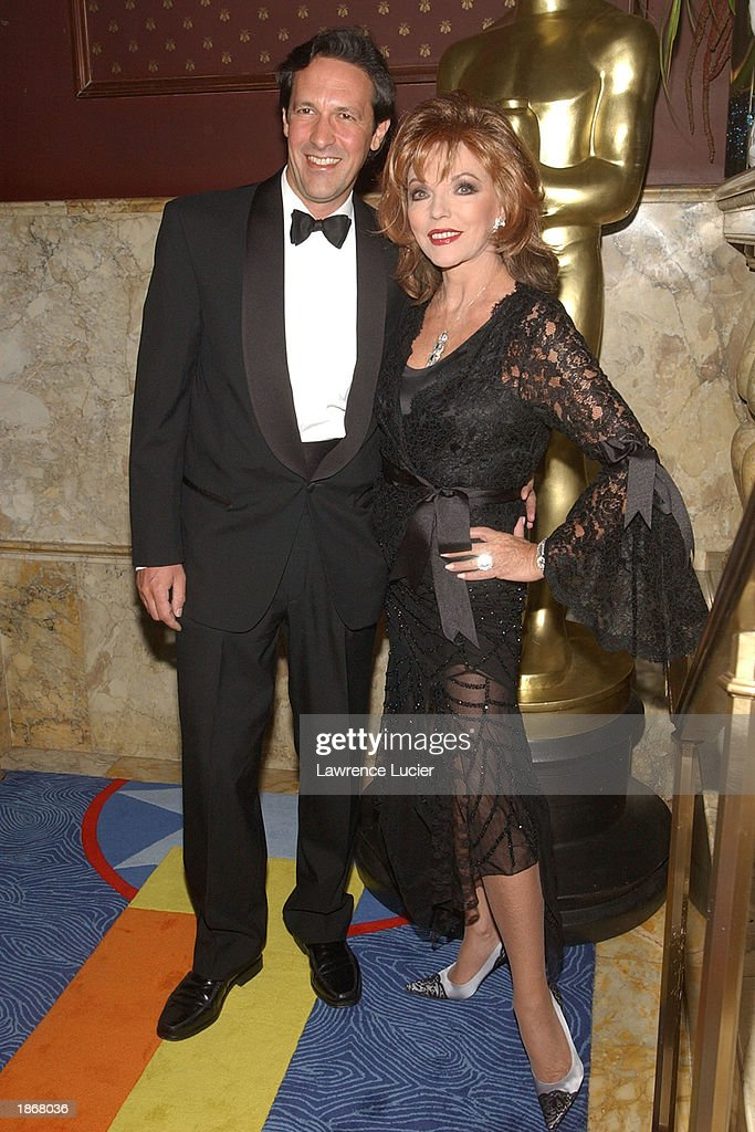 Theater company manager Percy Gibson and his wife Joan Collins (R) arrive at the official Academy of Motion Picture Arts & Sciences Oscar Night Viewing Party at Le Cirque 2000 restaurant March 23, 2003 in New York City.