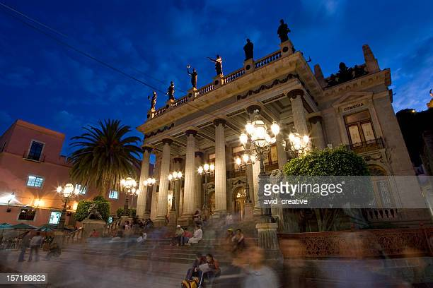 theater exterior at dusk with people milling around - guanajuato stock pictures, royalty-free photos & images