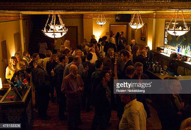 """Theater goers line up for drinks during intermission April 16, 2015 at the Ethel Barrymore Theater performance of """"The Curious Incident of the Dog in..."""