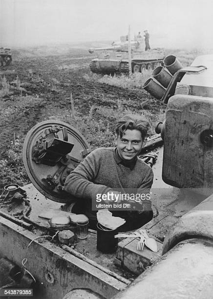2WW Theater of war eastern front the radio operator of a german 'Tiger' tank crew preparing sandwiches for himself and his comrades August 1943