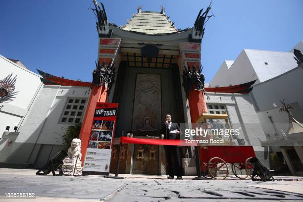 Theater Operations Manager Levi Tinker cuts the ribbon for the re-opening of the TCL Chinese Theater forecourt at TCL Chinese Theatre on June 24,...